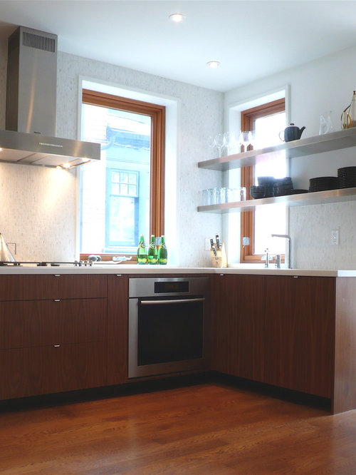 example of a minimalist kitchen design in toronto with stainless steel appliances open cabinets and