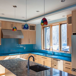 Design ideas for a mid-sized contemporary l-shaped open plan kitchen in Raleigh with a single-bowl sink, flat-panel cabinets, light wood cabinets, recycled glass benchtops, blue splashback, glass sheet splashback, stainless steel appliances, with island, brown floor, multi-coloured benchtop and bamboo floors.