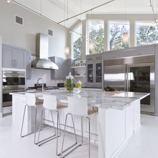 Example of a trendy kitchen design in Orlando with shaker cabinets, stainless steel appliances, marble countertops, gray cabinets and gray countertops