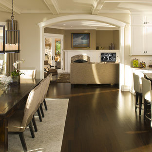 This is an example of a classic kitchen/diner in Minneapolis with white cabinets.