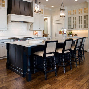 Traditional kitchen inspiration - Example of a classic kitchen design in Miami with glass-front cabinets, white cabinets and white backsplash