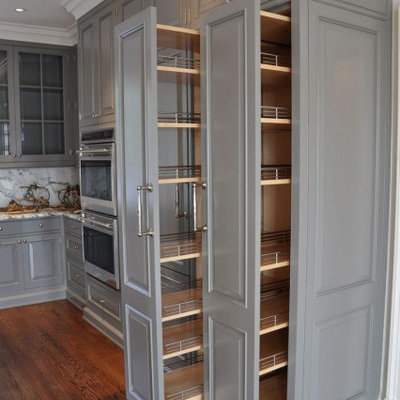 Elegant kitchen photo in Columbus with raised-panel cabinets and gray cabinets