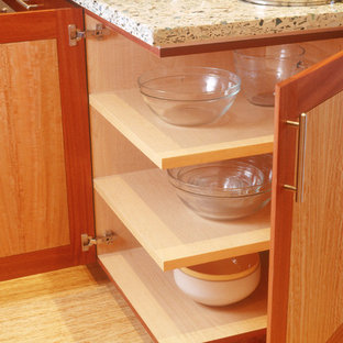 This is an example of a mid-sized contemporary galley eat-in kitchen in San Diego with a drop-in sink, flat-panel cabinets, light wood cabinets, concrete benchtops, coloured appliances, bamboo floors and with island.