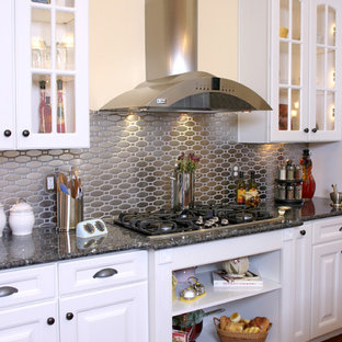 Elegant Kitchen Photo In Jacksonville With Granite Countertops Metallic Backsplash And Metal