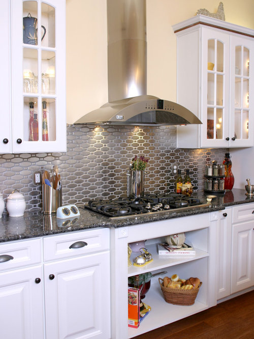 with granite countertops metallic backsplash and metal backsplash