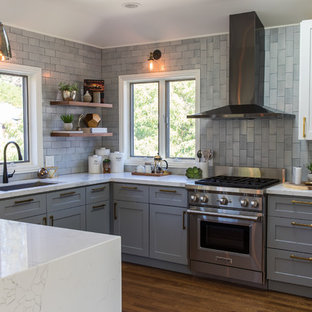 Transitional kitchen ideas - Inspiration for a transitional u-shaped medium tone wood floor and brown floor kitchen remodel in San Francisco with an undermount sink, louvered cabinets, gray cabinets, gray backsplash, stainless steel appliances and turquoise countertops