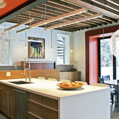 Trendy eat-in kitchen photo in Chicago with an undermount sink, flat-panel cabinets and medium tone wood cabinets
