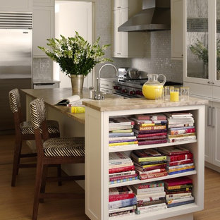 Eat-in kitchen - mid-sized traditional l-shaped light wood floor eat-in kitchen idea in New York with shaker cabinets, white cabinets, white backsplash, mosaic tile backsplash, stainless steel appliances, a farmhouse sink, granite countertops and an island