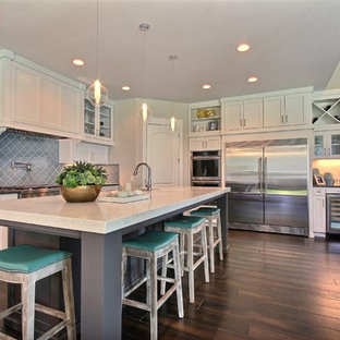 Huge transitional open concept kitchen ideas - Huge transitional l-shaped dark wood floor open concept kitchen photo in Portland with an undermount sink, recessed-panel cabinets, white cabinets, quartzite countertops, blue backsplash, glass tile backsplash, stainless steel appliances and an island