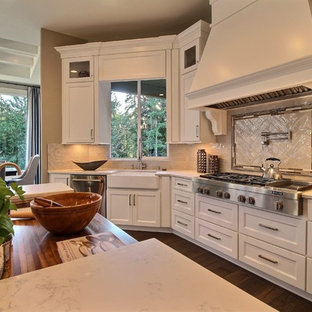 Huge transitional eat-in kitchen remodeling - Eat-in kitchen - huge transitional u-shaped dark wood floor eat-in kitchen idea in Portland with an undermount sink, recessed-panel cabinets, white cabinets, quartzite countertops, white backsplash, ceramic backsplash, stainless steel appliances and two islands