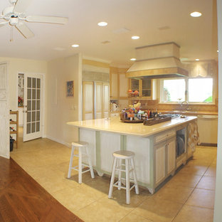 Photo of a large country u-shaped open plan kitchen in Miami with a triple-bowl sink, glass-front cabinets, distressed cabinets, marble benchtops, yellow splashback, marble floors and with island.