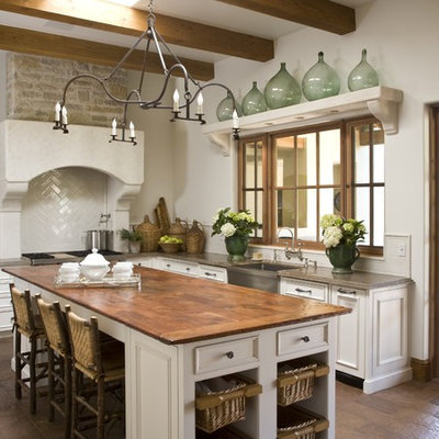Elegant kitchen photo in Phoenix with a farmhouse sink and wood countertops
