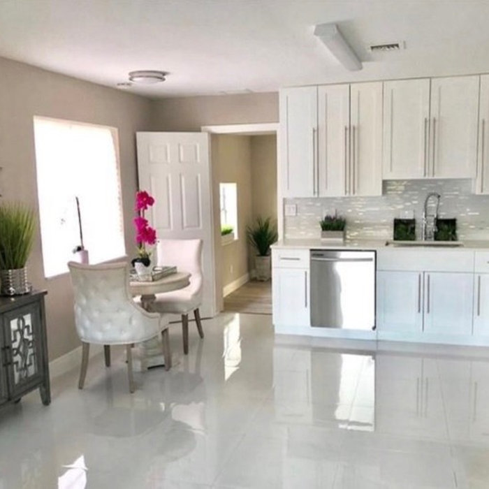 Open concept kitchen - small modern l-shaped porcelain tile and white floor open concept kitchen idea in Miami with an undermount sink, shaker cabinets, white cabinets, stainless steel appliances, no