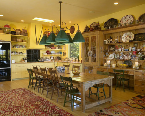 Inspiration For A Southwestern Eat In Kitchen Remodel In Santa Barbara With  Yellow Cabinets And