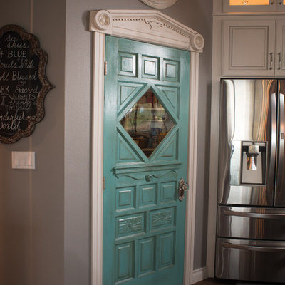 Inspiration for a huge shabby-chic style galley dark wood floor eat-in kitchen remodel in Other with a farmhouse sink, raised-panel cabinets, distressed cabinets, granite countertops, gray backsplash, stainless steel appliances and two islands