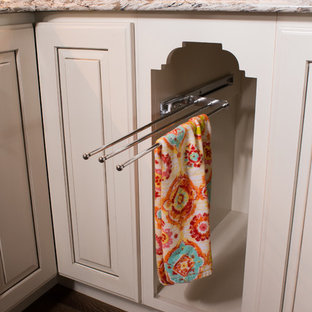 Huge shabby-chic style eat-in kitchen inspiration - Eat-in kitchen - huge shabby-chic style galley dark wood floor eat-in kitchen idea in Other with a farmhouse sink, raised-panel cabinets, distressed cabinets, granite countertops, gray backsplash, terra-cotta backsplash, stainless steel appliances and two islands