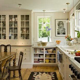 Eat-in kitchen - country eat-in kitchen idea in Burlington with a drop-in sink, open cabinets, white cabinets, white backsplash, marble countertops and stone slab backsplash