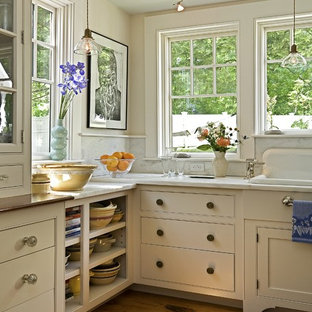 Inspiration for a traditional kitchen in Burlington with a drop-in sink, marble benchtops, open cabinets, beige cabinets and marble splashback.