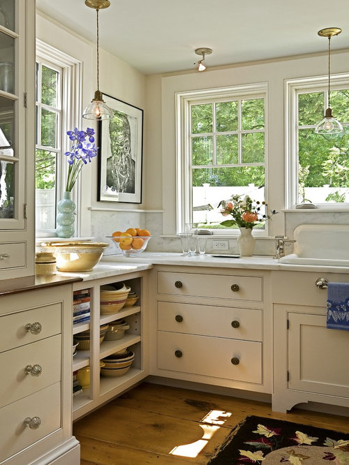 Elegant Kitchen Photo In Burlington With A Drop In Sink, Marble  Countertops, Open