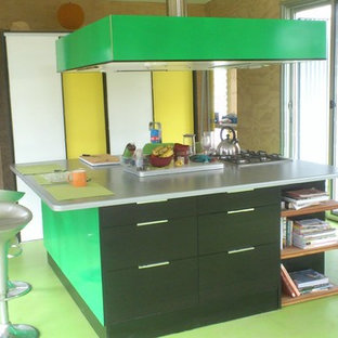 Photo of a small contemporary kitchen in Sydney with an undermount sink, flat-panel cabinets, laminate benchtops, panelled appliances, painted wood floors, with island, green floor and green benchtop.