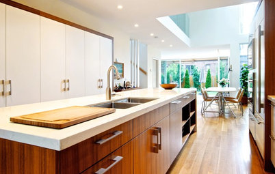 See How Wood Warms Modern White Kitchens