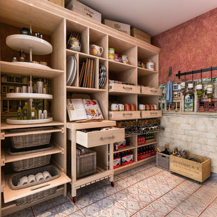 This is an example of a medium sized mediterranean u-shaped kitchen pantry in Los Angeles with shaker cabinets, light wood cabinets and ceramic flooring.