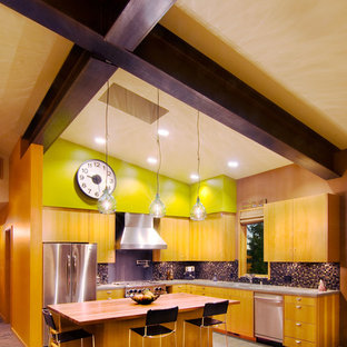 Kitchen - contemporary kitchen idea in Sacramento with flat-panel cabinets and medium tone wood cabinets