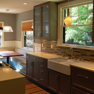 Inspiration for a small transitional enclosed kitchen remodel in Portland with a farmhouse sink, recessed-panel cabinets, gray cabinets, quartz countertops, glass tile backsplash, stainless steel appliances and an island
