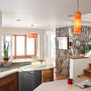 Inspiration for a traditional u-shaped kitchen/diner in Portland Maine with recycled glass countertops, a submerged sink, shaker cabinets, medium wood cabinets and stainless steel appliances.
