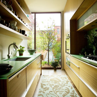 Example of a trendy galley enclosed kitchen design in Birmingham with an undermount sink, open cabinets, light wood cabinets and green countertops