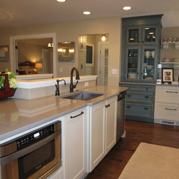 Kitchen with Blue Cabinets Features Unique Layout