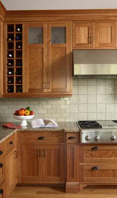 Natural Cherry Cabinets And White Glass Subway Tile Backsplash