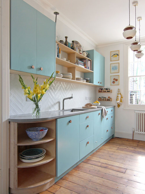 Small scandi single-wall kitchen in Other with a submerged sink, flat-panel