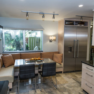 Small contemporary u-shaped eat-in kitchen in Other with a double-bowl sink, flat-panel cabinets, light wood cabinets, granite benchtops, green splashback, slate splashback, stainless steel appliances, slate floors, no island and green floor.