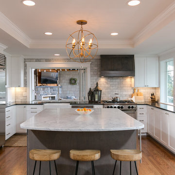 Kitchen with large island and vaulted ceiling