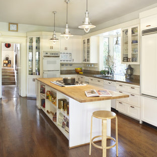 Medium sized country l-shaped kitchen/diner in San Francisco with wood worktops, a submerged sink, shaker cabinets, white cabinets, dark hardwood flooring, an island, integrated appliances, brown floors and brown worktops.