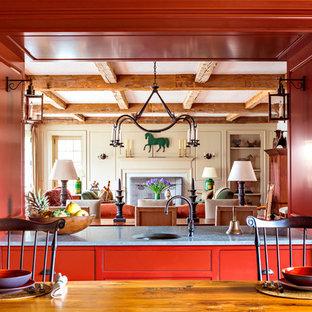 Ispirazione per una cucina ad ambiente unico country con lavello sottopiano, ante rosse e ante di vetro