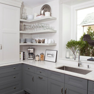 Mid-sized transitional eat-in kitchen ideas - Example of a mid-sized transitional u-shaped dark wood floor eat-in kitchen design in Philadelphia with an undermount sink, recessed-panel cabinets, gray cabinets, quartzite countertops, white backsplash, ceramic backsplash, paneled appliances and an island