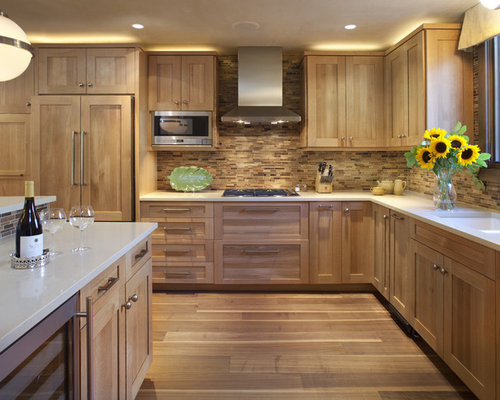 contemporary kitchen idea in denver with paneled appliances - Kitchen Design With Oak Cabinets