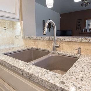 Kitchen in Sacramento with a double-bowl sink, beige cabinets, quartz benchtops, beige splashback, stone slab splashback and white appliances.