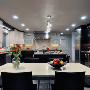 Photo of a large contemporary l-shaped eat-in kitchen in New York with stainless steel appliances, an undermount sink, black cabinets, multi-coloured splashback, ceramic floors and with island.