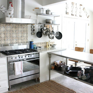 Kitchen - eclectic kitchen idea in Chicago with stainless steel appliances, white cabinets and multicolored backsplash