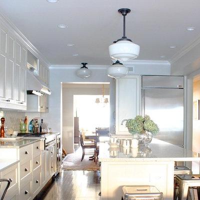 Elegant kitchen photo in Chicago with stainless steel appliances, shaker cabinets, white cabinets, white backsplash, subway tile backsplash and granite countertops