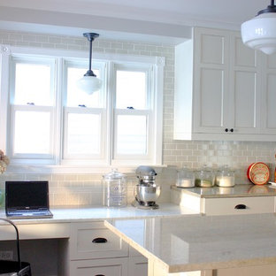 Kitchen - traditional kitchen idea in Chicago with recessed-panel cabinets, white cabinets, granite countertops, white backsplash and subway tile backsplash