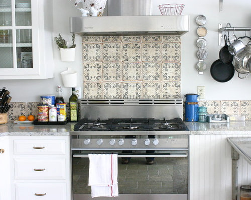 Inspiration For An Eclectic Kitchen Remodel In Chicago With White Cabinets,  Multicolored Backsplash And Stainless