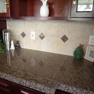 Example of a classic kitchen design in Las Vegas with granite countertops, beige backsplash and stone tile backsplash
