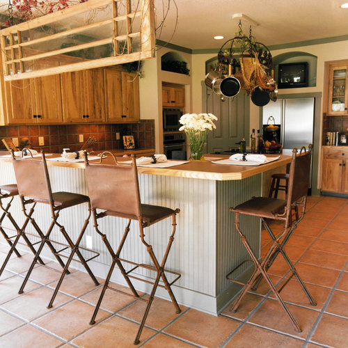 Rustic Eat In Kitchen Pictures   Example Of A Mountain Style Terra Cotta  Floor