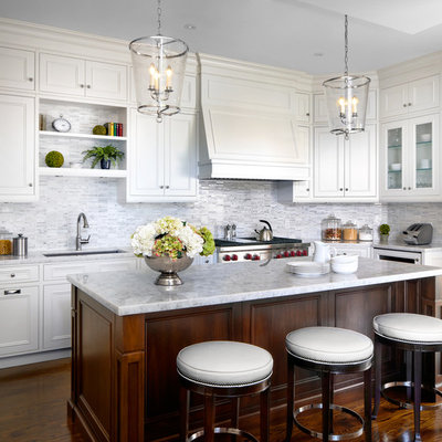 Elegant l-shaped dark wood floor kitchen photo in Toronto with an undermount sink, recessed-panel cabinets, white cabinets, multicolored backsplash, mosaic tile backsplash, stainless steel appliances and an island