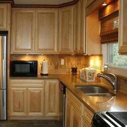 ... Back splash pops out with the lighting underneath the upper cabinets