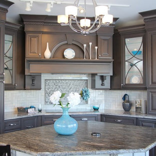 Design ideas for a mid-sized modern u-shaped separate kitchen in Chicago with a double-bowl sink, raised-panel cabinets, grey cabinets, granite benchtops, grey splashback, stainless steel appliances, mosaic tile splashback, with island and brown benchtop.